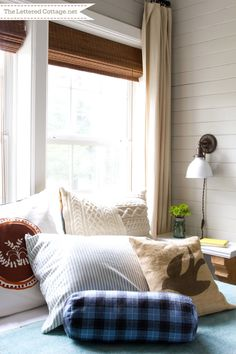 Guest Bedroom Reveal | The Lettered Cottage, love side table/shelf, wall light and of course the horizontal board walls