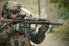 Marine Special Operations Team - Operator A Critical Skills Operator (CSO), a member of a MARSOC Marine Special Operations Team (MSOT) provides security during an operation in Helmand province, Afghanistan, 2013. MSOTs have been working closely with local Afghan military and police forces on joint counter insurgency operations in Afghanistan. This MSOT operator is wearing a MICH 2001 helmet fitted with side rails and a NVG mount.