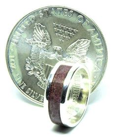 American silver eagle coin ring with purple heart wood inlay Silver Eagle Coins, Silver Eagles, Purple Heart Wood, Wood Inlay Rings, Coin Ring, Wedding Bands, Rings For Men, Engagement Rings, Personalized Items