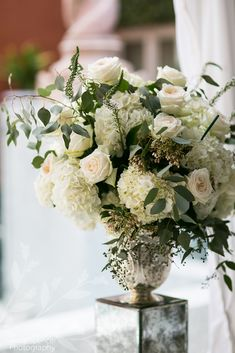 White and blush wedding ceremony floral arrangement with seeded eucalyptus. Harvey Designs florist.