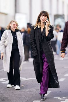 PARIS, FRANCE - SEPTEMBER 29:  Lou Doillon wears a black coat and purple pants, outside Haider Ackermann, during Paris Fashion Week Womenswear Spring/Summer 2019, on September 29, 2018 in Paris, France.  (Photo by Edward Berthelot/Getty Images)