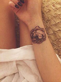 flower tattoo via Tattoologist