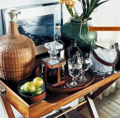 RL's tropical style bar ...<3 the tray stand and the wicker covered bottle.
