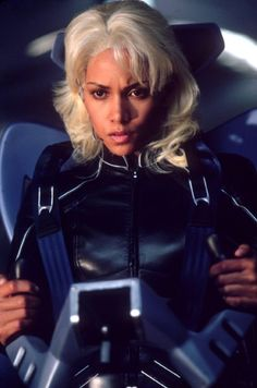 Our Favorite Female Action Heroes and a Few Villains, Too photos, including production stills, premiere photos and other event photos, publicity photos, behind-the-scenes, and more. - Titles: X-Men 2 Names: Halle Berry Characters: Storm  Still of Halle Berry in X-Men 2 (2003)