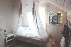 teenage room // love the drapes over the bed