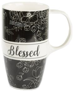 """[""""This 17 oz latte mug is perfect for early morning coffee and late night hot cocoa. It has a black and white floral design, and the word Blessed in big cursive letters. A perfect gift for a friend or family member, or a perfect item for your own kitchen collection.<br><br><b>Product Details:<\/b><br>Coffee Mug<br>Holds up to 17 ounces<br>Material: Ceramic<br>Message: Blessed""""] $9.99"""