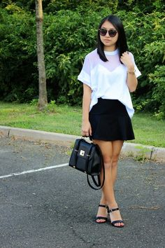 Shop this look for $133:  http://lookastic.com/women/looks/skater-skirt-and-satchel-bag-and-heeled-sandals-and-sunglasses-and-watch-and-crew-neck-t-shirt/3157  — Black Skater Skirt  — Black Leather Satchel Bag  — Black Leather Heeled Sandals  — Black Sunglasses  — Gold Watch  — White Mesh Crew-neck T-shirt