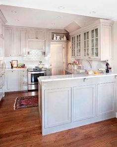 This may be perfect if we can't remove the half wall.... make the counter slightly longer for bar stools and stick a table on the outside of it for fancy dinners! ;)