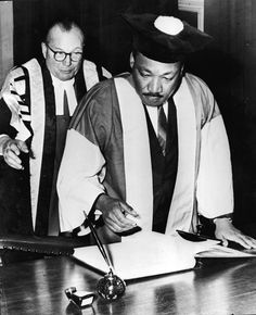 American civil rights leader Dr. Martin Luther King, Jr. (1929 – 1968), watched by Dr. Charles Bousenquet, signs the Degree Roll At Newcastle University after receiving an honorary Doctor of Civil Law degree, Newcastle, England, November 14, 1967. (Photo by /Getty Images)