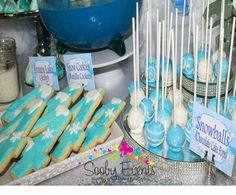 Snowflake Frozen birthday party cookies and cake pops! See more party planning ideas at CatchMyParty.com!