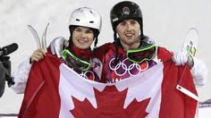 Alex Bilodeau (right) celebrates with fellow Canadian Mikael Kingsbury after Bilodeau won gold and Kingsbury took silver in the men's moguls final.