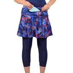 """Liberty CapriSkirt  Perfect for Fourth of July or military races, this patriotic capris skirt combines our popular SwingStyle skirt with cute, functional navy capris. The 6x6"""" thigh pockets carry your gear discreetly, while the 12"""" zippered waistband pocket, which can be worn front or back, securely holds your ID, debit card, car key and more. The standard fabric wicks away sweat to help keep you cool. Show your love for the red, white, and blue with this cute and functional CapriSkirt."""