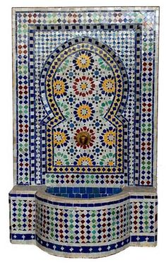 Moorish hand chiseled tile fountain, a piece of moorish achitecture history. These fountains are still used in palaces, hotels and riads in old moroccan cities.
