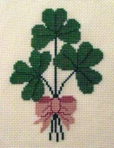 A trio of shamrocks tied with a pink ribbon. Pattern includes DMC floss suggestions and complete instructions. For best results, the pattern should be printed in color. Overall design size: 54 stitches wide by 70 stitches high. 123 Cross Stitch, Free Cross Stitch Charts, Simple Cross Stitch, Cross Stitch Flowers, Cross Stitch Designs, Cross Stitch Patterns, Cross Stitching, Cross Stitch Embroidery, Embroidery Patterns