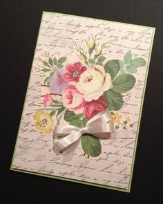 The script background paper is not by Anna Griffin, but other materials are. The rose bouquet is fussy-cut from her French Floral Paper Kit.