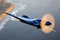 Kevin Eldredge flies his race airplane, Relentless over the surf near Miramar, Calif. Photo by Jessica Ambats
