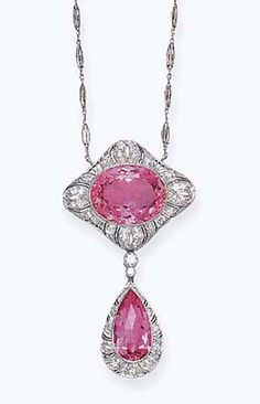 A BELLE EPOQUE PINK TOPAZ AND DIAMOND PENDANT NECKLACE, BY BAILEY, BANKS & BIDDLE  Designed as a pendant, set with a pear-shaped rose-cut pink topaz, within a single-cut diamond and pierced openwork surround, to the collet-set diamond link and single-cut pierced openwork plaque, set with an oval-cut pink topaz, suspended from a fancy link chain, mounted in platinum, circa 1910, 19½ ins.  Signed BB for Bailey, Banks & Biddle, no. 58826