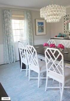 Dining Room - Schumacher Santa Monica Ikat Drapes in Blue with Helser Brother French Poles in Alabaster.  Woven Wood Shades by Horizon Shades.