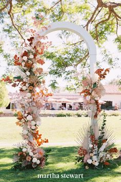 A simple white arch gets elevated with staggered bold colored flowers in an asymmetrical pattern. #weddingideas #wedding #marthstewartwedding #weddingplanning #weddingchecklist Simple Wedding Arch, Wedding Arch Rustic, Floral Wedding, Wedding Flowers, Wedding Arches, Wedding Ideas, Wedding Trends, Wedding Colors, Wedding Chuppah