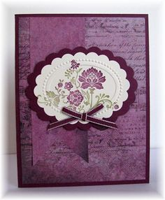 """""""The card - stamped image is from SU(Fresh Vintage).  I inked the stamp with markers, then used the oval embossing folder(Designer Frames) from SU.  Then I punched it out with a Marvy scalloped punch and added a layer with a bigger scallop punch.  The paper is from Fab Scraps.  Colors are razzleberry, artichoke and vanilla."""""""