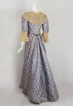 House of Worth, silk brocaded gown, 1890s. Back view. From VintageTextile.
