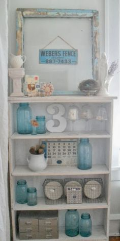 Blue Mason Jars add the perfect color to otherwise neutral decorating. ~ Mary Walds Place - must love junk