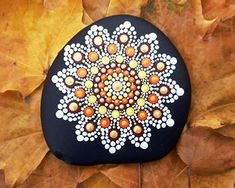 Painted rock magnificent flower mandala home decoration by Elena Marisol Gomez