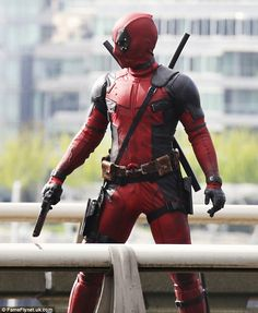 Photos of Ryan Reynolds and His Stunt Double in Costume as Deadpool, Filming an Action Scene on Vancouver Set