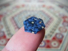 reproduction of an antique Australian quilt.  This is, I think, insanely too small.