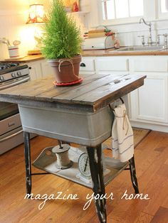 This smart blogger repurposed a vintage washtub as a rustic kitchen island with hidden storage.