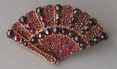Victorian Bohemian Garnet Fan Brooch. Dates to approximately 1890. Beautiful high quality Bohemian garnets are set in a heavily gold plated brass mounting which was referred to as 'Garnet Gold', this was typical for Victorian jewelry particularly garnet jewelry.