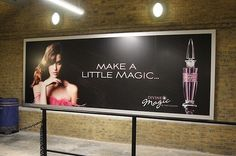 At King's Cross Station, there's a perfume ad that resembles the one Harry and Dumbledore stand by in Half-Blood Prince. | 17 Hidden Gems Harry Potter Fans Should Look For In Diagon Alley At Universal Orlando