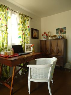 desk in front of window with curtains.