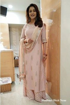 Featuring an elegant, Jaipur pink kurta with intricate gotapatti embroidery at the neckline, sleeves and dupatta; paired with a pair of beautiful printed palazzos.
