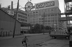 Daily Life in the old version of Jersey City. Two kids biking around in the late afternoon with the the Colgate plant hovering in the background. Jersey City, New Jersey, Colgate Palmolive, Retro Pictures, City Restaurants, City Scene, Lower Manhattan, Old City, Old Town