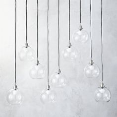 Industrial modern chandelier by Mark Daniel suspends nine glass globes from nickel-finished iron canopy. Pendants stagger in length on black cords 19 to Great look with filament bulbs or our candelabra bulb. Globe Pendant Light, Modern Pendant Light, Modern Chandelier, Pendant Lighting, Pendant Lamp, Chandeliers, Capiz Chandelier, Outdoor Chandelier, Black Chandelier