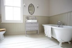 Vanity color, add trim detail under chair rail and paint it shades darker. Looks good with white tile floor.