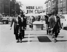 """A group of African-American men, dressed in tuxedos, walk down the middle of a street carrying a coffin and a sign saying """"Here lies Jim Crow"""" as a demonstration against segregation laws in Black History, Art History, History Facts, Detroit History, Jim Crow, Civil Rights Movement, African American History, Black People, Civilization"""