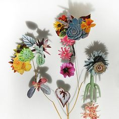 Dutch artist Anne Ten Donkelaar lays pressed wildflowers, dried stems, and paper cutouts on top of tiny little pins to create the most spectacular three dimensional collages.