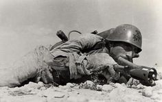 An Italian Flame thrower operator in Africa 1942.