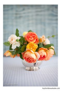 Color inspiration for the centerpieces… orange, yellow, and green with pops of blush.