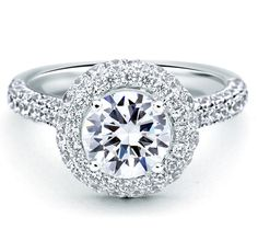 Style ME2151 This modern classic engagement ring features a double pave halo and pave band