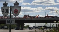 Canadians pay tribute to Master Cpl. Kristal Giesebrecht and Pte. Andrew Miller on the Highway of Heroes. The soldiers were killed by a roadside bomb in Afghanistan (2010)
