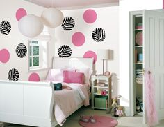 Very cute girls room in white and pink with touches of stripes and zebra print (bet you didn't even notice the striped accent pillow)! Love the white room with pops of color, makes it easier to transition later when she wants a teenager room! Instead of a nightstand, I'd do a corner bookshelf - you can't go wrong. Love the polka dots and use of space.