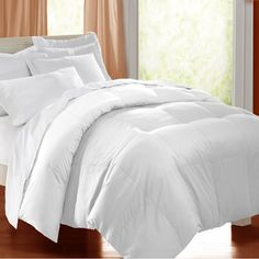 @Overstock.com - All Cotton Supreme Natural Down Fiber Blend Comforter - Perfect all year long, this is the best natural-blend comforter on the market today. With a combination of feathers and down fiber, it can be used on its own or with a duvet cover, and it is carefully constructed to keep the filling evenly distributed.   http://www.overstock.com/Bedding-Bath/All-Cotton-Supreme-Natural-Down-Fiber-Blend-Comforter/891497/product.html?CID=214117 $62.99