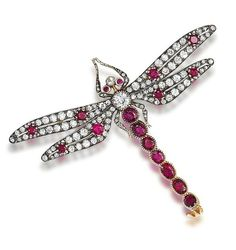 A ruby and diamond dragonfly brooch  The body and wings set with old brilliant and rose-cut diamonds and circular-cut rubies, the abdomen with oval-cut rubies, mounted en tremblant, diamonds approximately 4.40 carats total, length 6.4cm, fitted case by Richard Digby, Sloane Street, London SW1. Victorian or Victorian style.