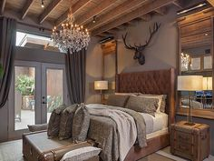 The Master Bedroom has expansive open rafter ceilings, exposed ductwork, a fabulous rustic crystal chandelier. Palo Verde – Houston Business Journal Source by myNest_ Farmhouse Style Master Bedroom, Bedroom Decor Design, Master Bedrooms Decor, Restoration Hardware Bedroom, Bedroom Colors, Home, Home Bedroom, Remodel Bedroom, Home Decor