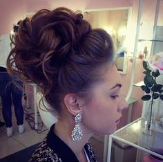Formal updo. Pinned curls piled high around the crown with a bouffant at the front.