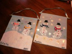 Footprint Snowmen Canvas, I just made these with my kids and they are so much fun and make really cute gifts for the grandparents too, its a nice keep sake to bring out every christmas :)