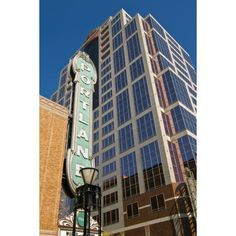 Low angle view of Portland landmark sign and modern skyscraper Portland Oregon USA Canvas Art - Panoramic Images (36 x 12)
